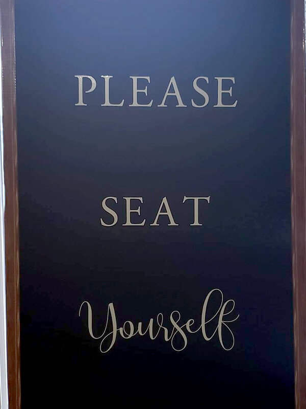 """Please Seat Yourself"" Sign"